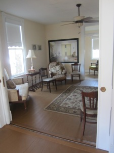 Two adjoining rooms are set up as a salon space in the Rose O'Neill house.
